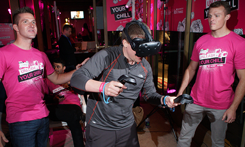Man experiencing a virtual reality skiing game at an event