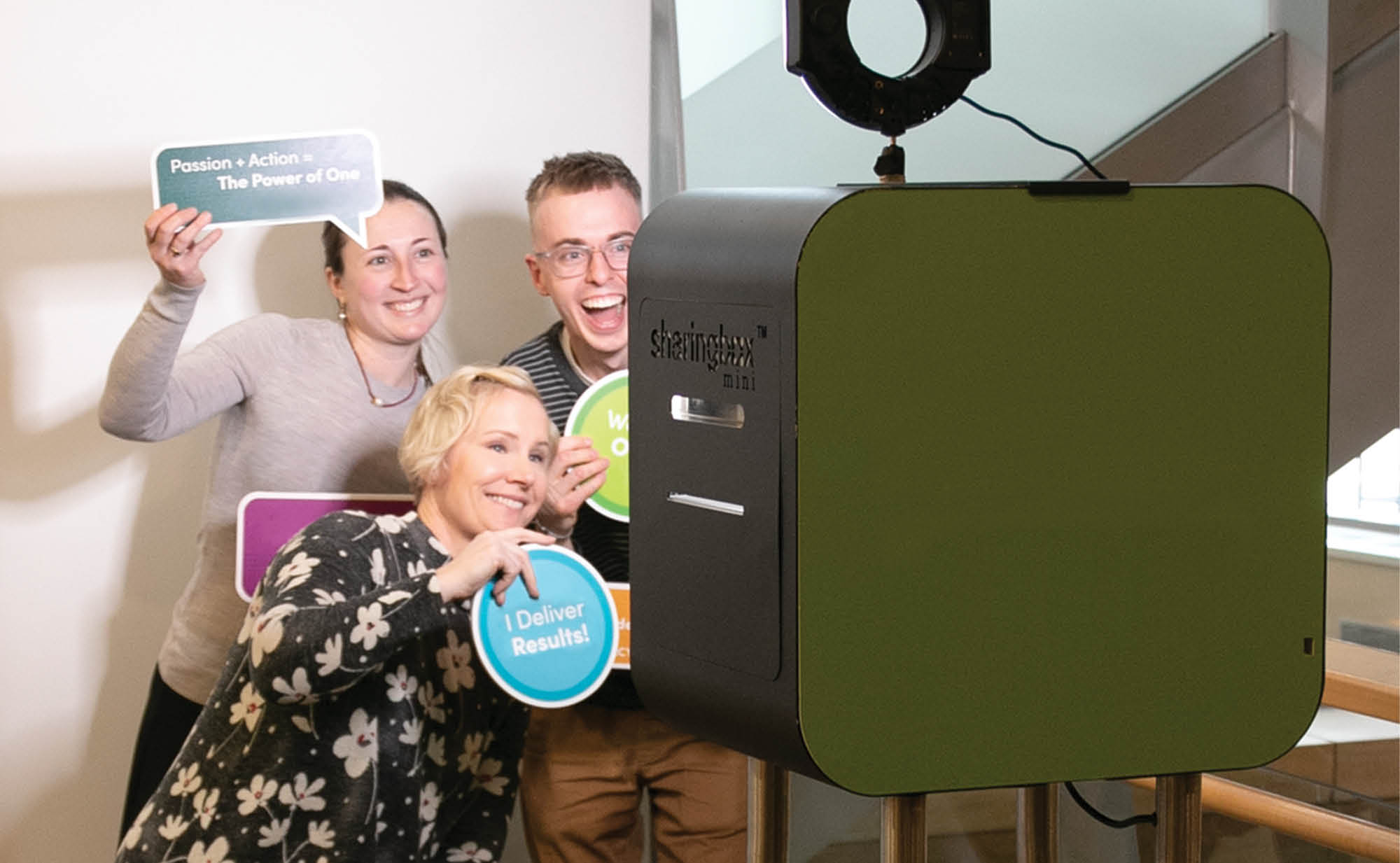 employees participating in a photo booth