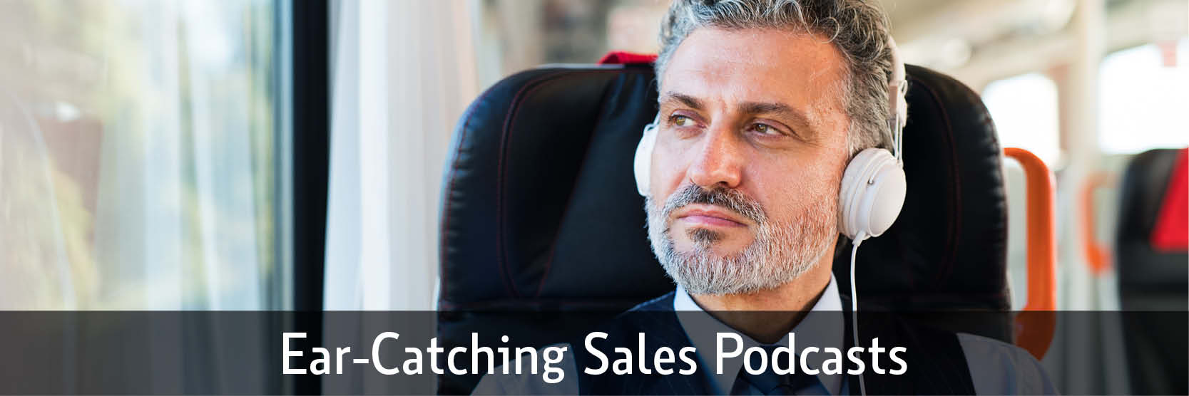 man listening to a sales podcast while riding train