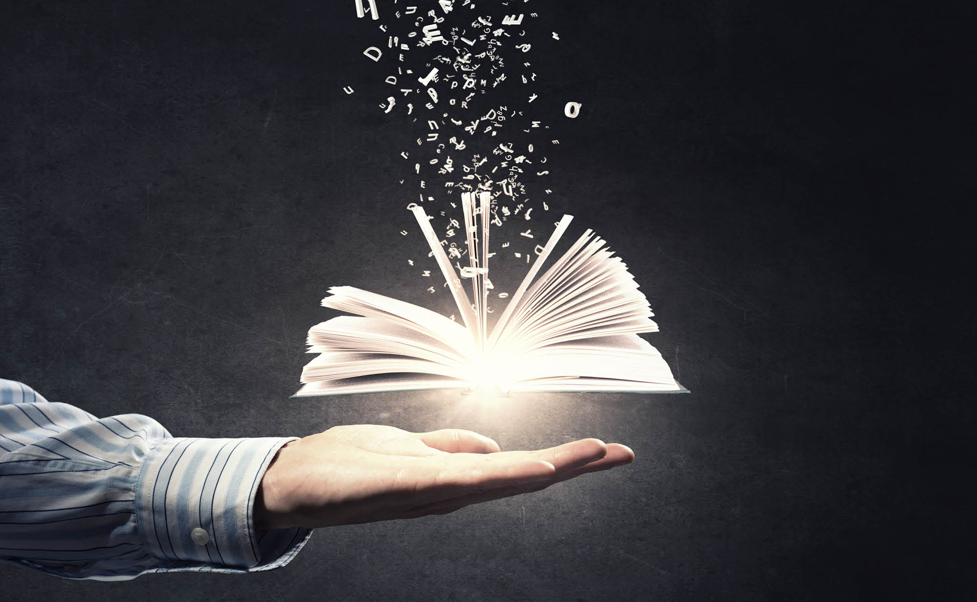open book in hand representing having the right message to reach your audience