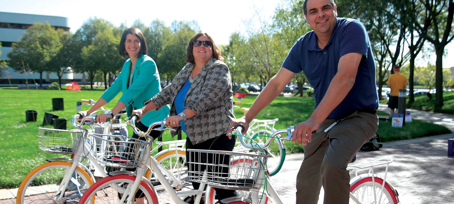 ITA Group employees riding the company bikes outside