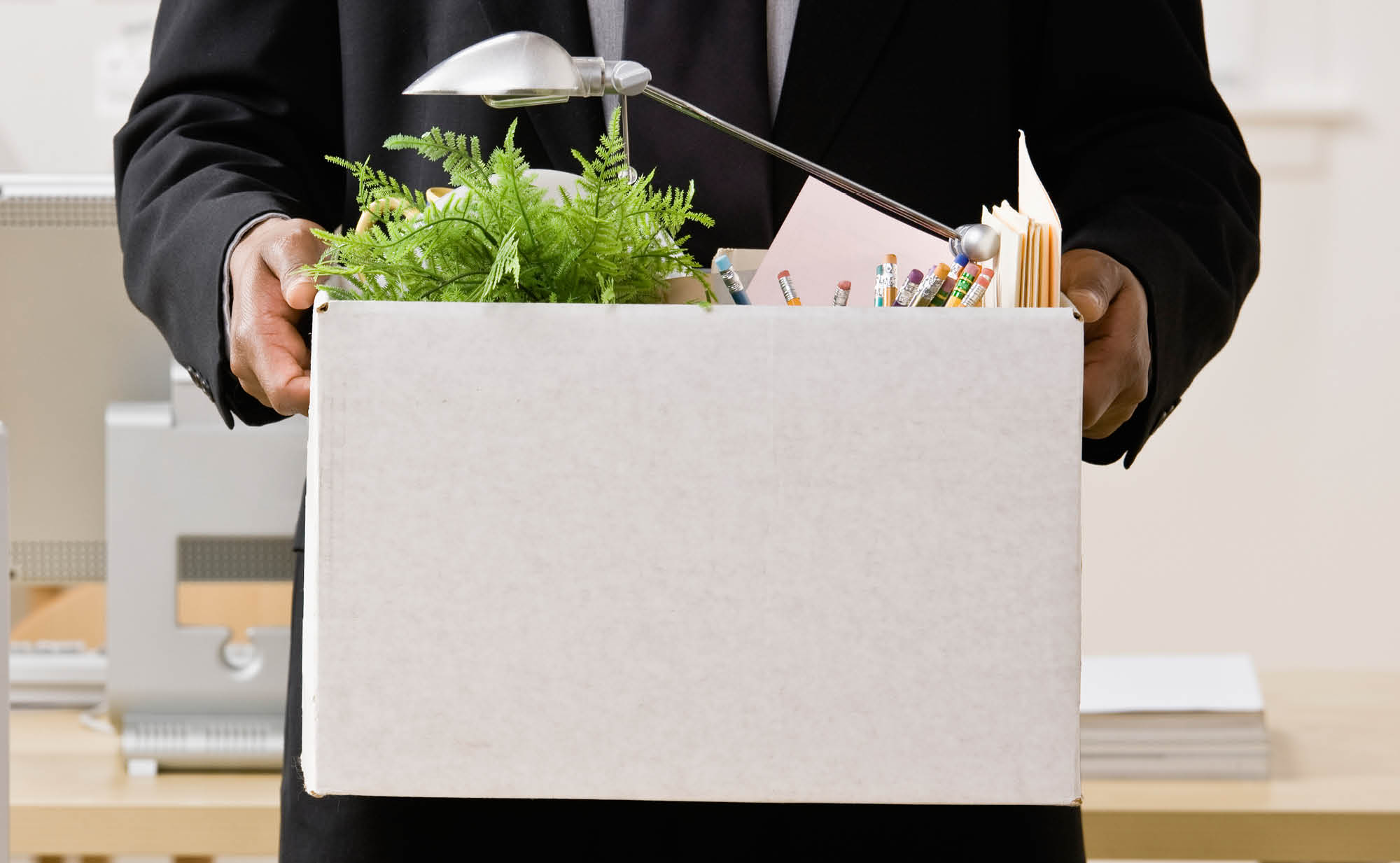 Man holding box of office items