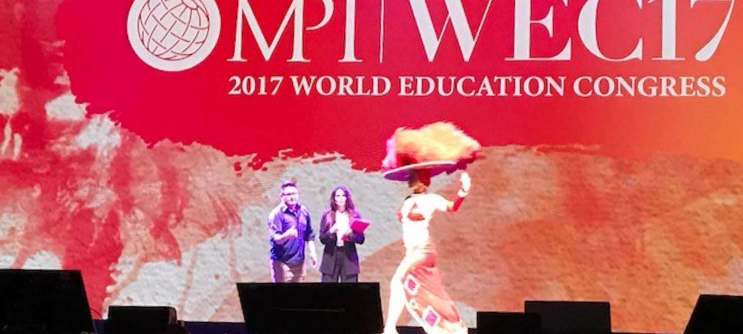 People on stage at MPI 2017 World Education Congress
