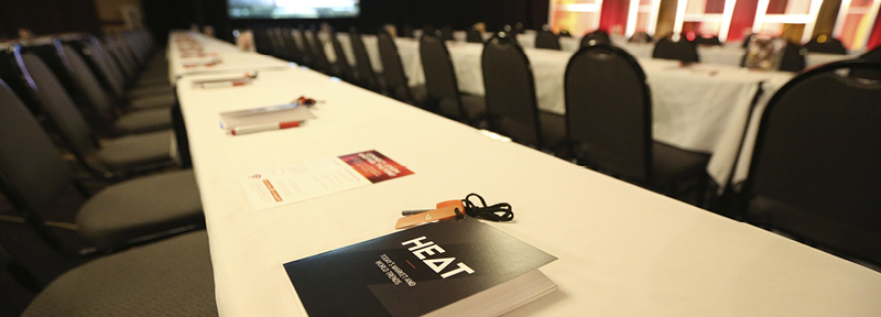 Sales meeting tables set up with communication elements for attendees