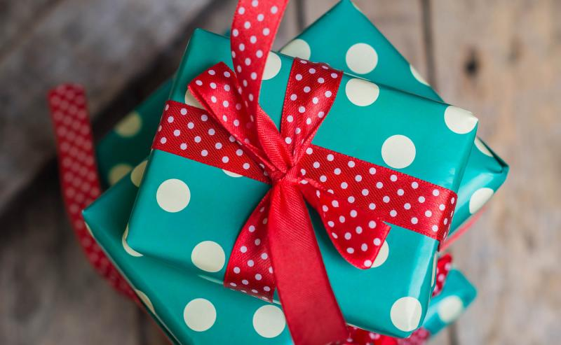 Stack of wrapped holiday gifts