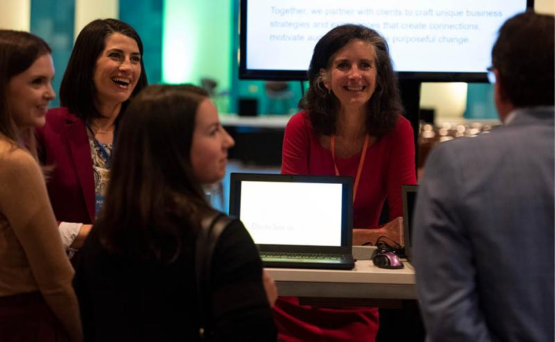 People networking at an employee event