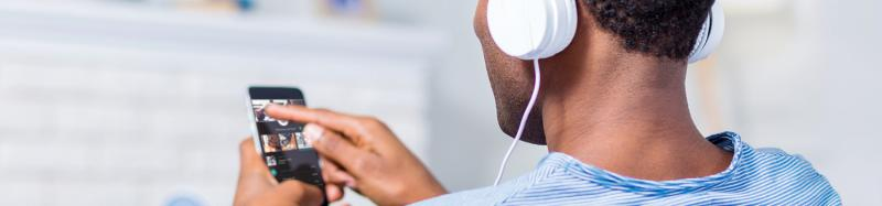 man listening to work from home playlist