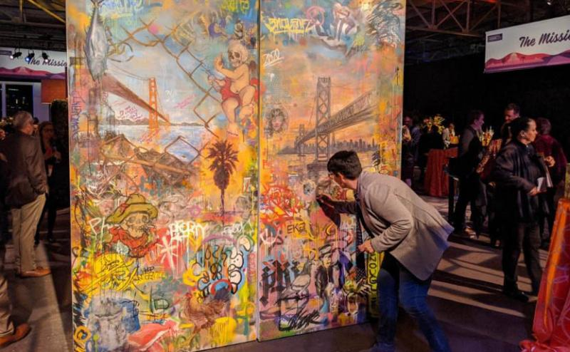 attendee interacting with mural wall at strategic event