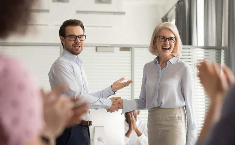Employee being recognized by her manager