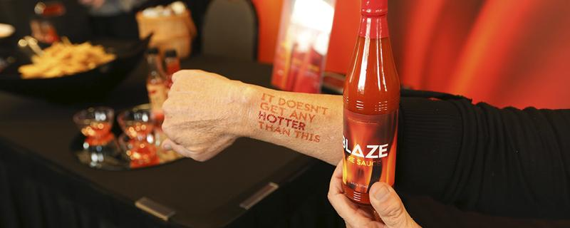Blaze branded event giveaways such as hot sauce and temporary tattoos