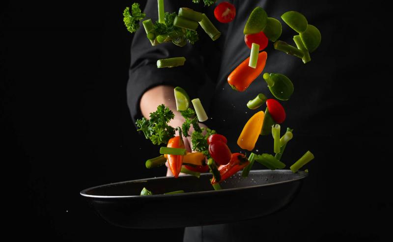 chef tossing ingredients to represent mergers and acquisitions