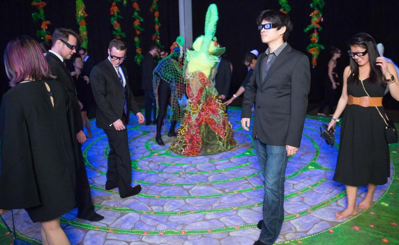 event attendees wearing 3-D glasses at interactive activity