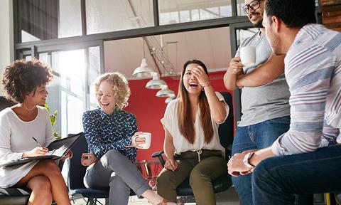 Team members laughing together