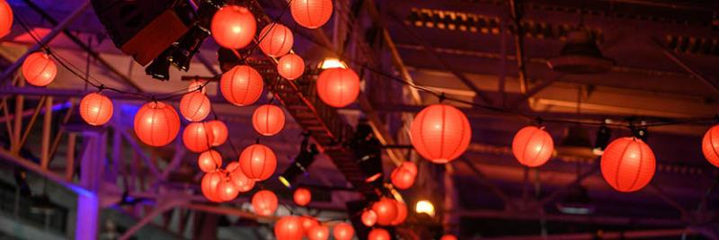 lanterns lining the ceiling at Chinatown-themed area at PCMA experiential event