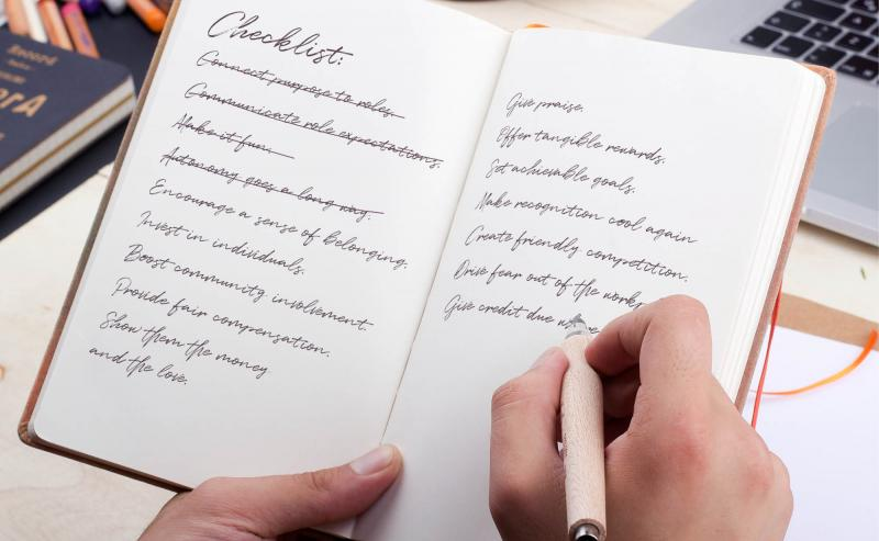 Motivation checklist written in a notebook