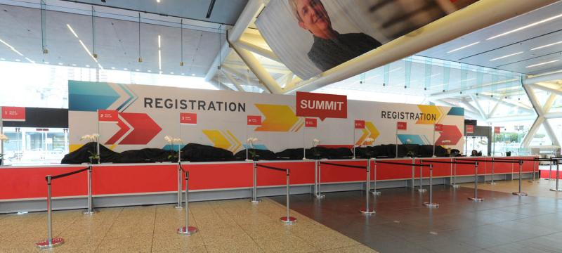 Event signage at the registration desk at a conference