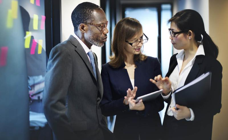 Coworkers discussing leadership style in office setting