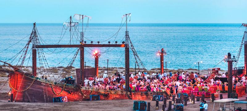 Giant pirate ship event venue on the beach during an incentive travel trip