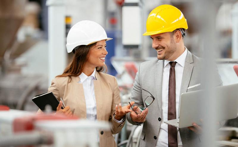 Two people discussing a contractor loyalty program in manufacturing environment