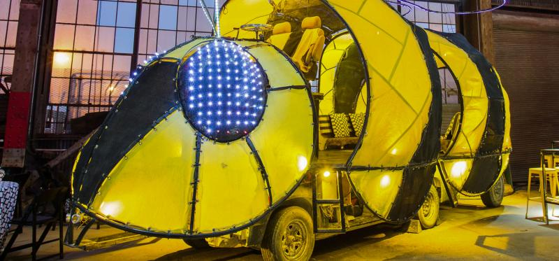 Vehicle shaped like a bee in an event space