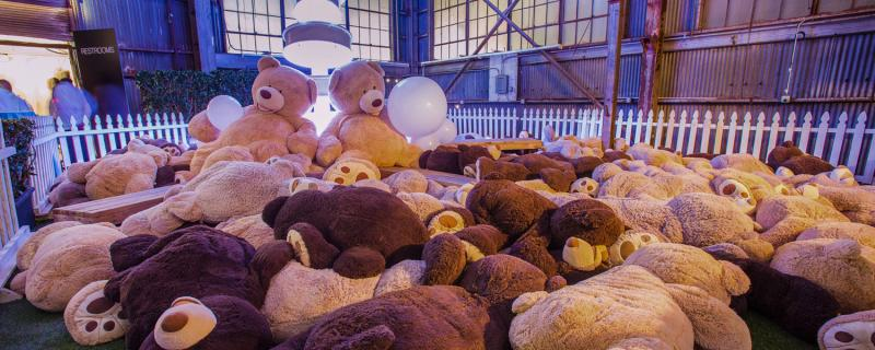 Pile of giant teddy bears at an event