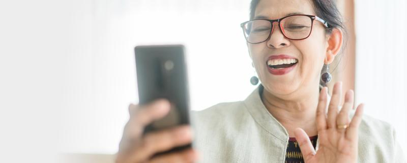 woman collaborating virtually with coworkers