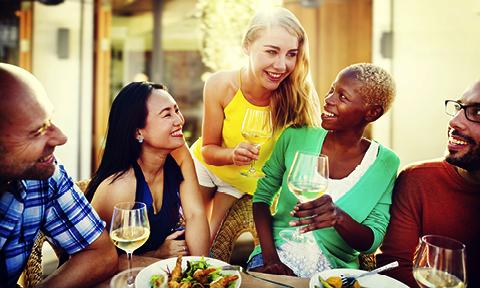 People dining together and networking on incentive travel trip