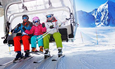 People riding ski lift on incentive travel trip