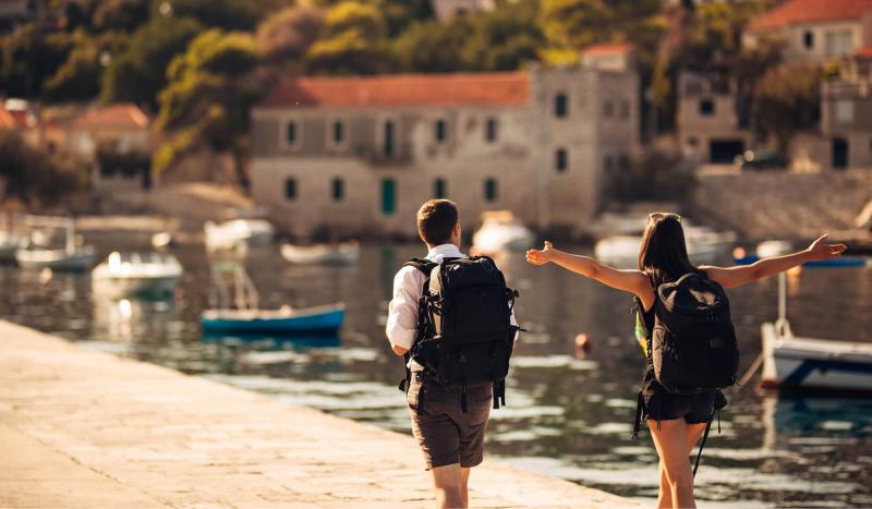 Couple walking along waterfront during incentive trip