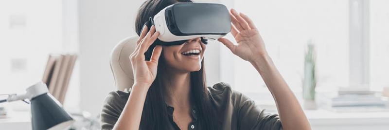 woman watching product launch on virtual reality goggles