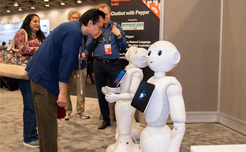 Event attendees interacting with a robot at an event