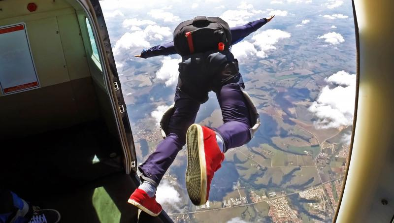 Person skydiving out of an airplane