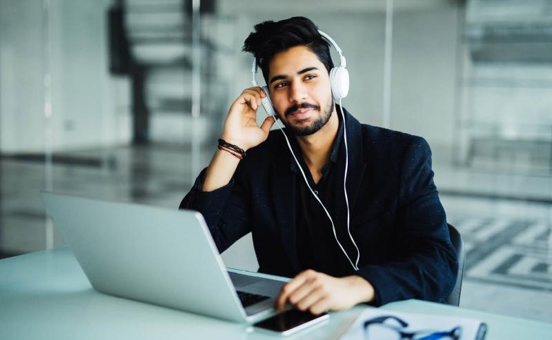 employee listening to healthy events podcast