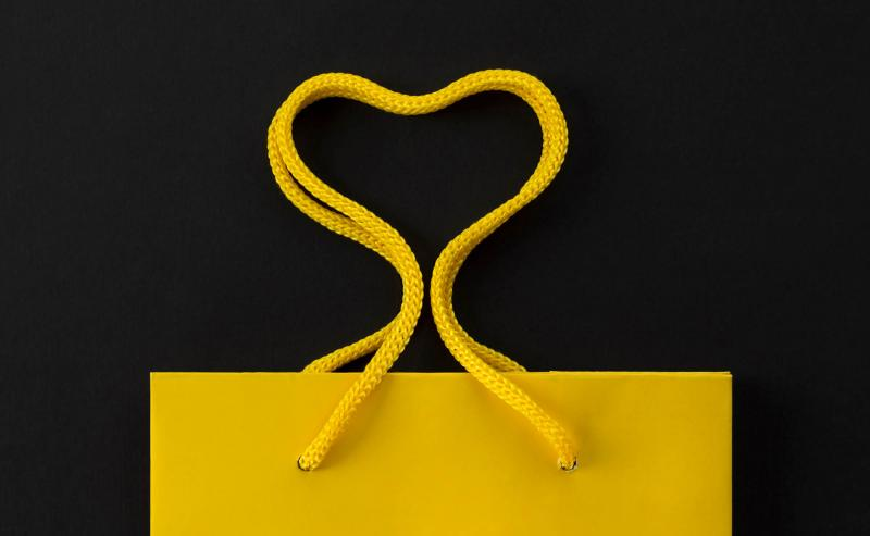 Yellow gift back isolated on a black background