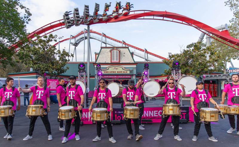 marching band at amusement park product launch event