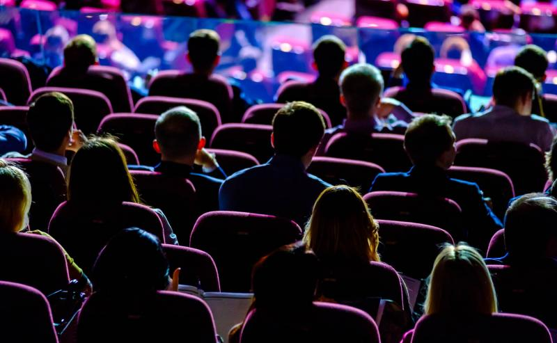 Group of event attendees listening to a keynote