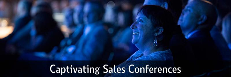 people in an audience at a sales conference
