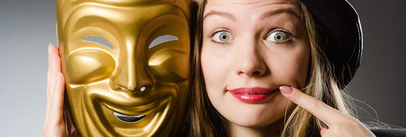 a girl with a perfomer mask next to her face