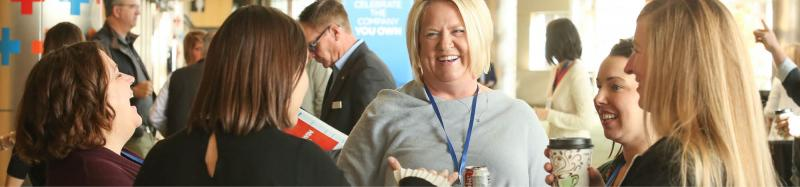 Employees networking at an event