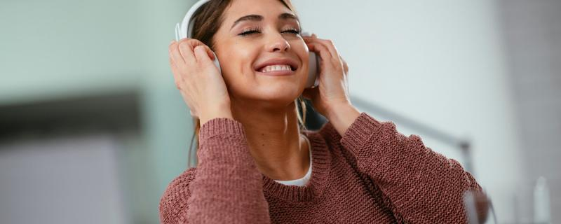 woman listening to music at desk